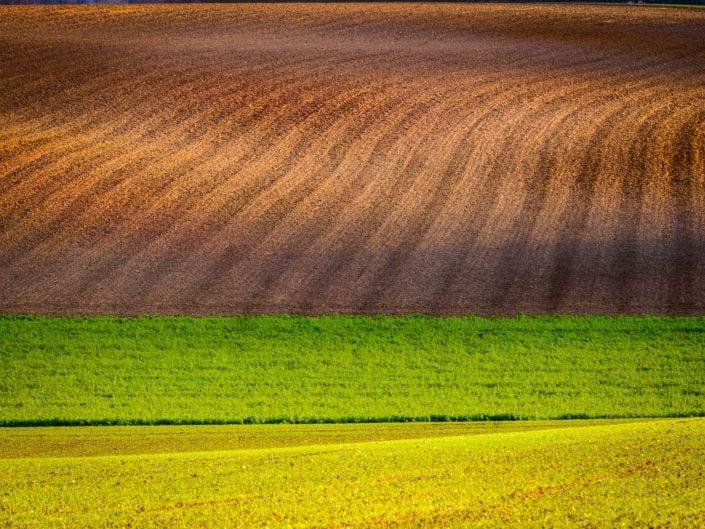 landscape photo of colourful rolling hills of Belgium near Bierbeek
