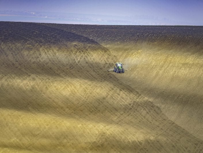 landscape photo fields undulating rolling fields agriculture Moravia, Czech Republic, spring, tractor plowing