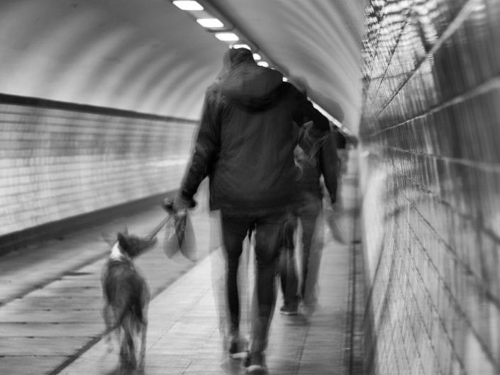 people walking in the tunnel of Antwerp beneath the Schelde river