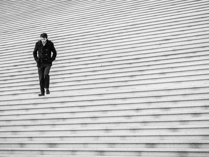 person on an immense white staircase
