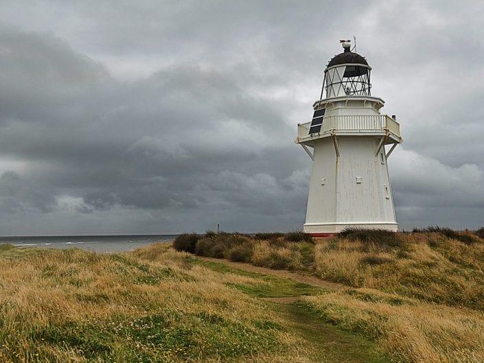 landscape photo, new zealand, lighthouse, south island, clouds, stormy