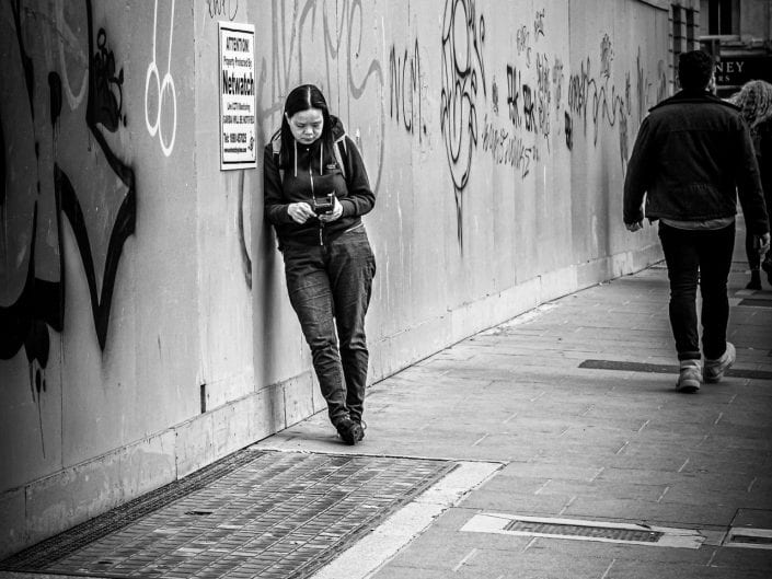 woman whatching her smartphone in the streets of Dublin