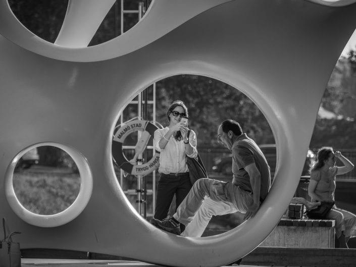 street photgrphy people posing in street art black and white