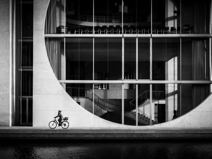 biker in Berlin in front of building in governmental quarter