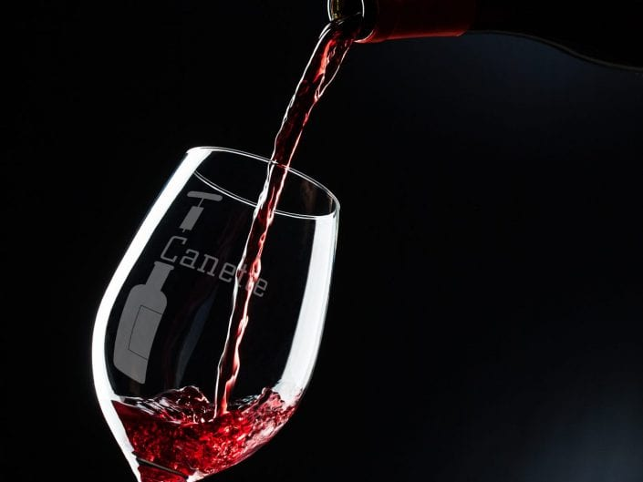 product photography of pouring red wine from a bottle into the glass, studio photography