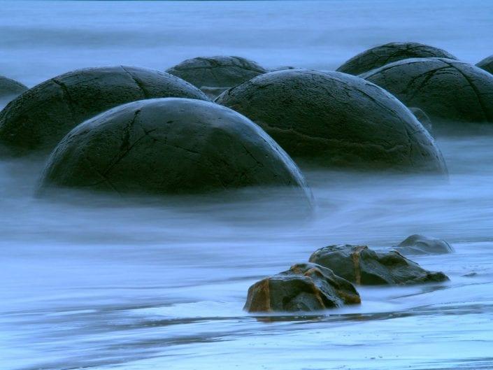 waterscape long exposure photo of Moeraki Boulders in New Zealand