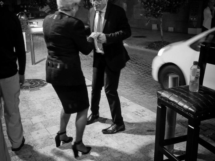 street photography black and white couple dancing in the streets of Santo Domingo, Dominican Republic