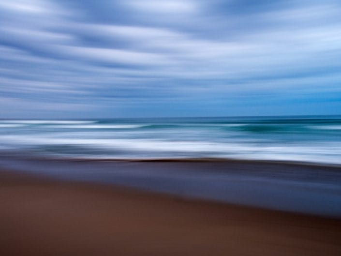 landscape photo of beach in New Zealand, North Island, with intentional camera movement