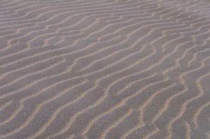 Minimalistische foto van het strandzand