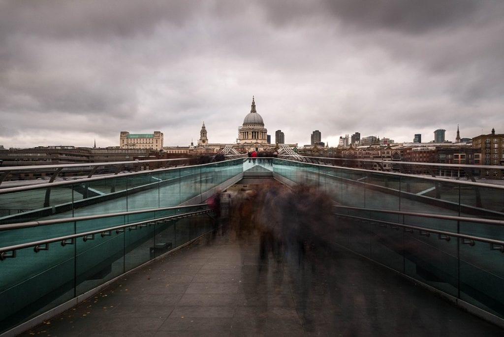 Blurred people on the millennium bridge london