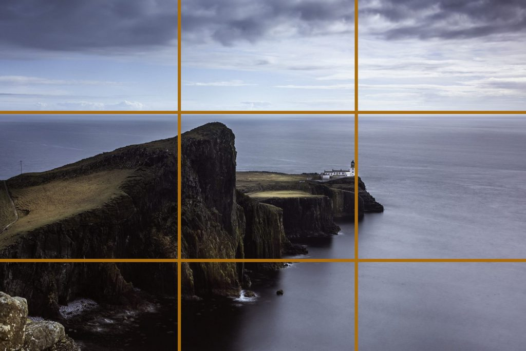 landscape photo of the famous Neist Point lighthouse in Scotland on the most westerly tip of the Isle of Skye near the township of Glendale illustrating the rule of thirds