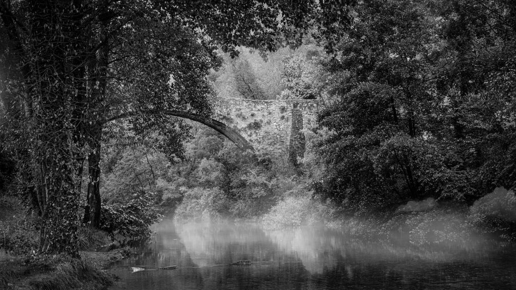 black and white landscape photo with a touch of mist adding drama to the scene