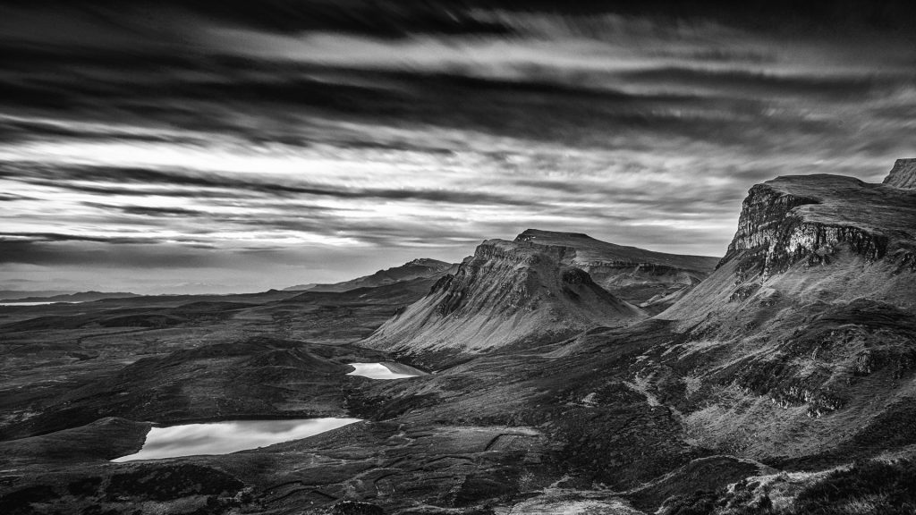 Black and white landscape photo with dramatic sky on the Isle of skye