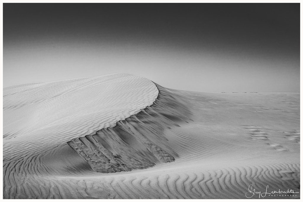 Desert structure in the ribbles of the sand black and white landscape photo